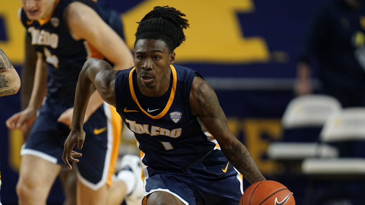 Toledo guard Jamere Hill plays against Michigan in the first half of an NCAA college basketball...