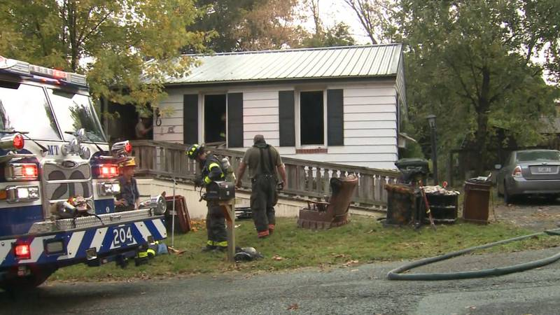A Pennsylvania woman carried her neighbor to safety after his house caught on fire.