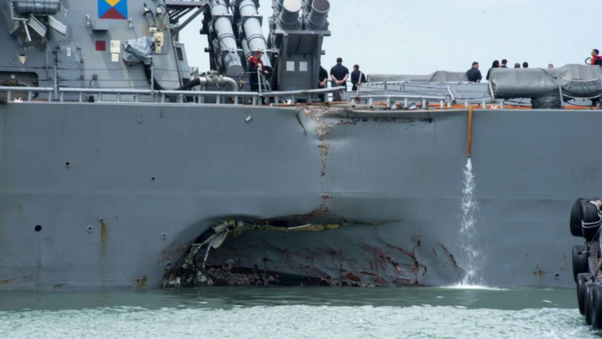 Damage to the portside is visible as the Guided-missile destroyer USS John S. McCain (DDG 56)...