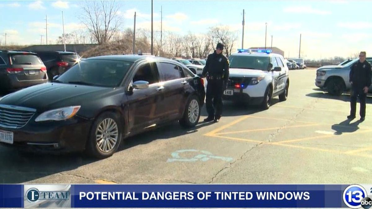 Law enforcement officers have to take extra precautions when approaching a vehicle with darkly...