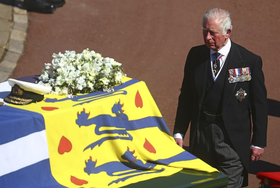 Prince Charles follows the coffin of his father Britain's Prince Philip during the funeral...