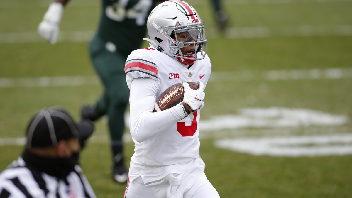 Ohio State's Garrett Wilson (5) runs against Michigan State during an NCAA college football...
