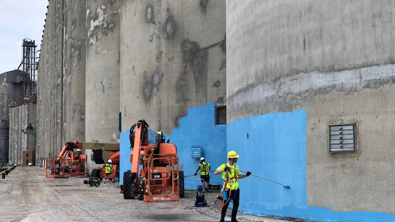 It is a massive mural being painted on dozens of silos in Toledo