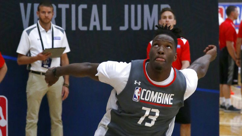 Nigel Hayes, from Wisconsin, participates in the running vertical jump at the NBA draft...
