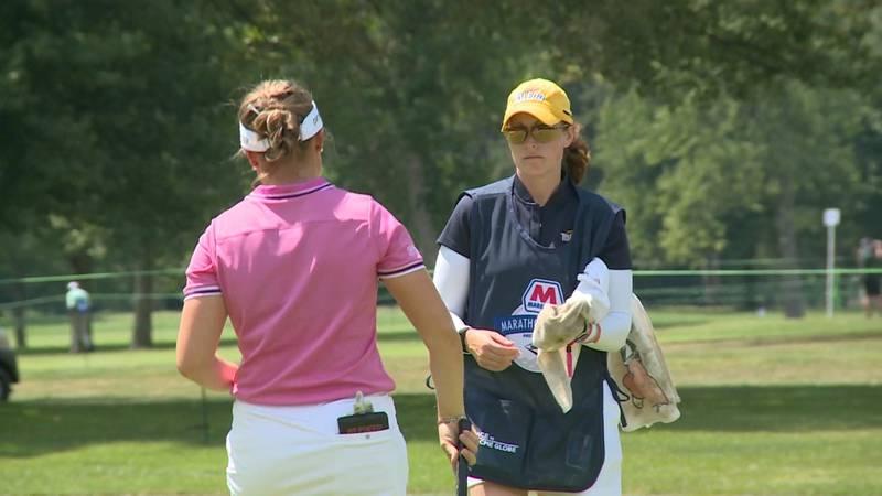 Last weekend, University of Toledo women's golf coach Jenny Coluccio caddied for LPGA rookie,...