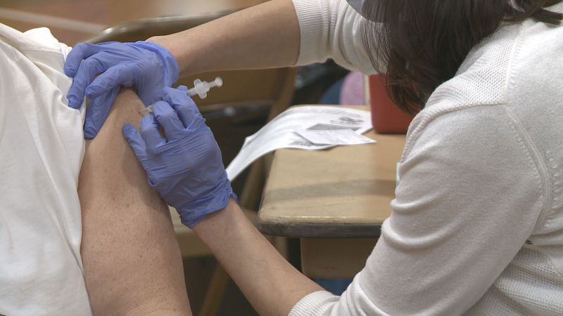 A Marquette County resident receives the Pfizer vaccine at Baraga Gym.