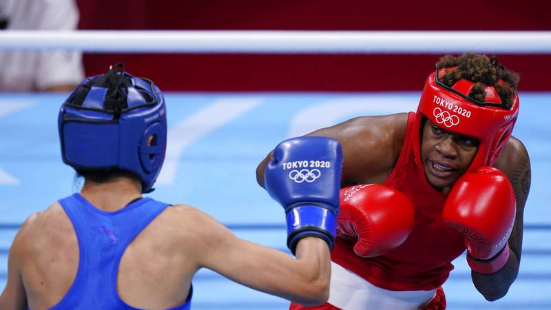 Oshae Jones, of Toledo, in red, and Hong Gu, of China, square off during their women's welter...