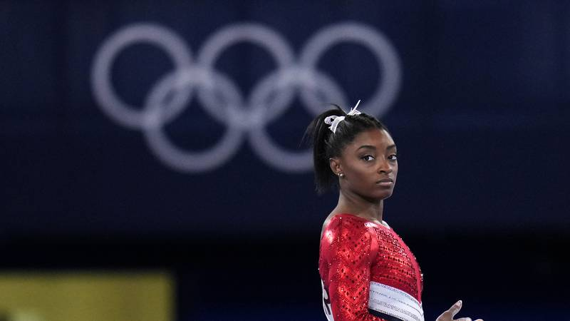 Simone Biles, of the United States, waits to perform on the vault during the artistic...