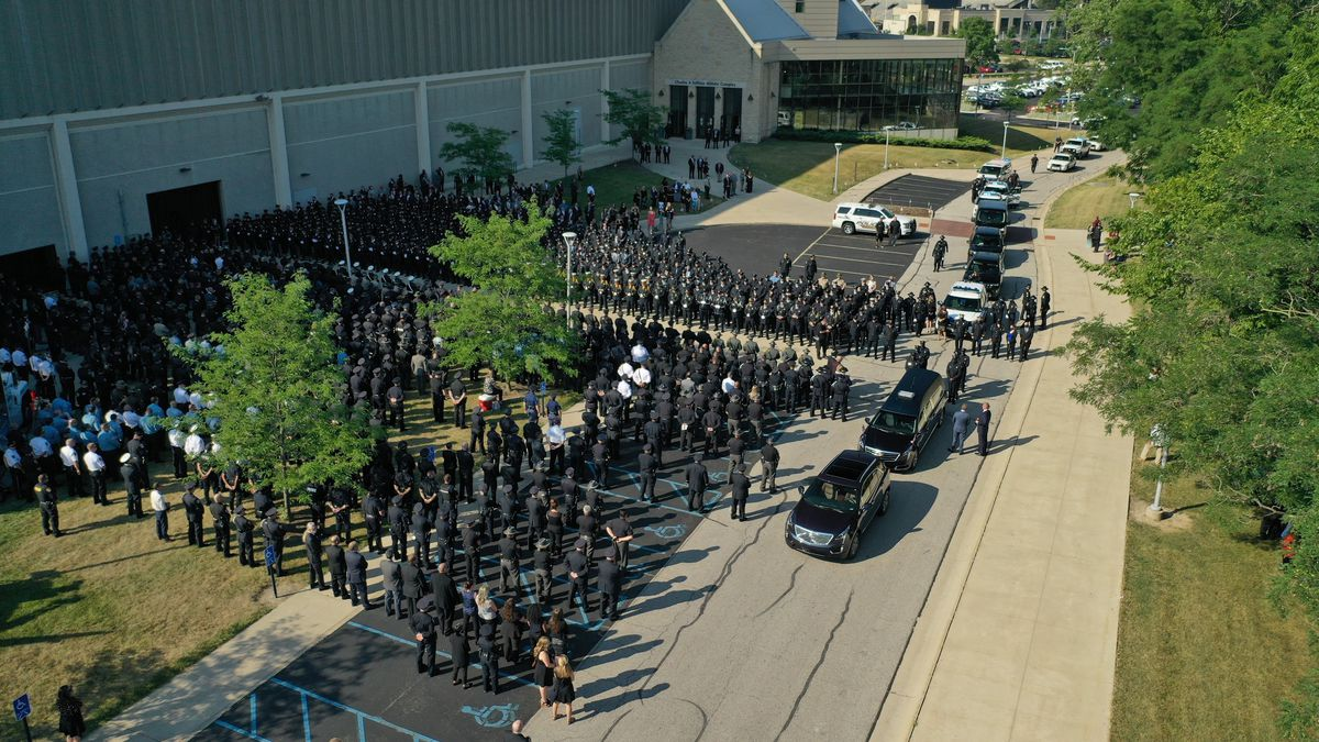 Members of the law enforcement community line up outside Savage Arena before TPD Officer Anthony Dia's memorial service Tuesday, July 7.
