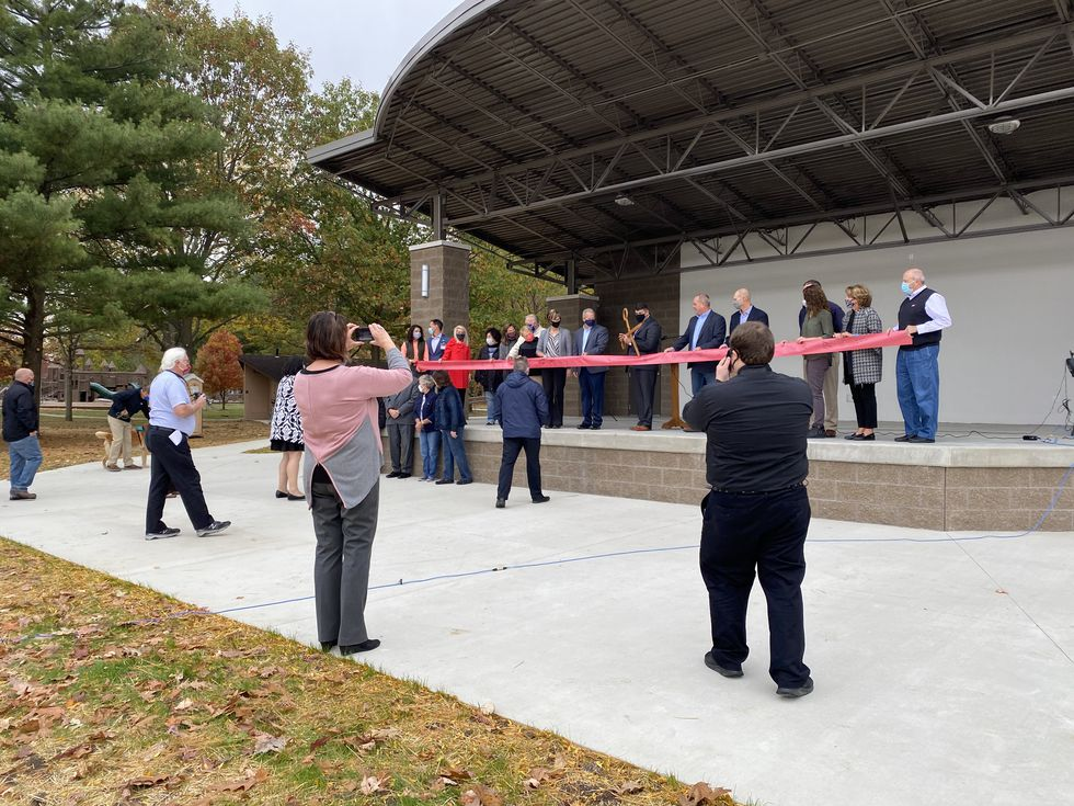 Investors stand on stage for the dedication and ribbon-cutting ceremony of the Fountain City...