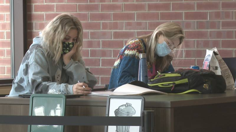 Students wear masks while studying on campus.