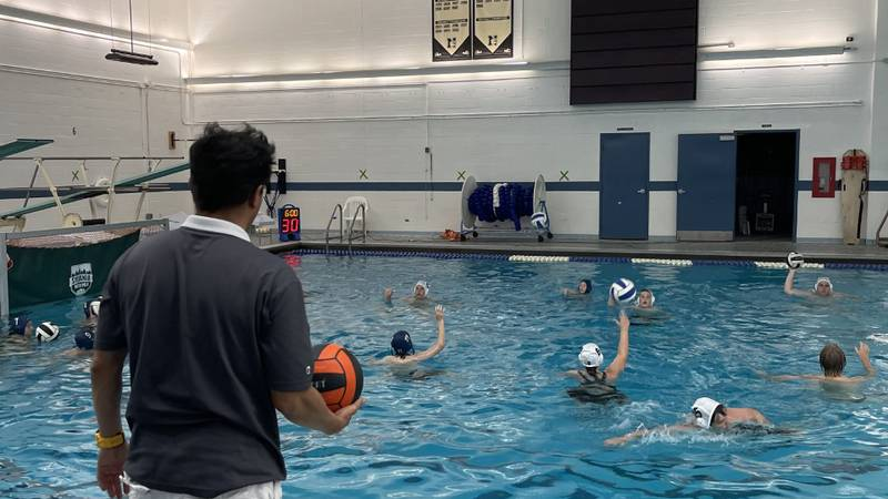 Head Coach Alberto Almedia watches as his team does drills. Almedia played water polo for 17...