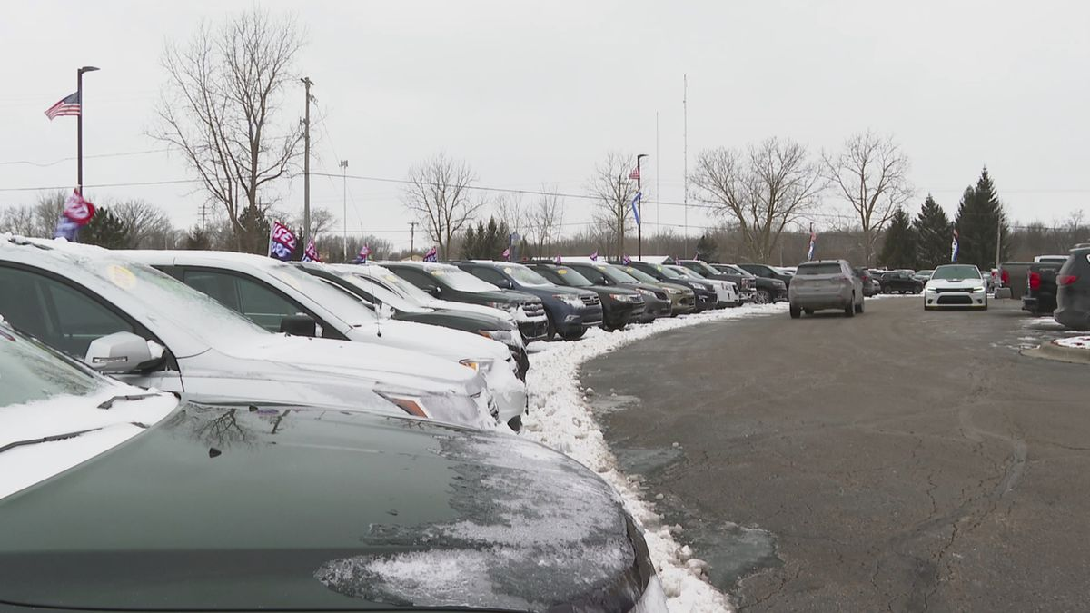 In this image made from video, cars drive through the used vehicle lot at a LaFontaine auto...