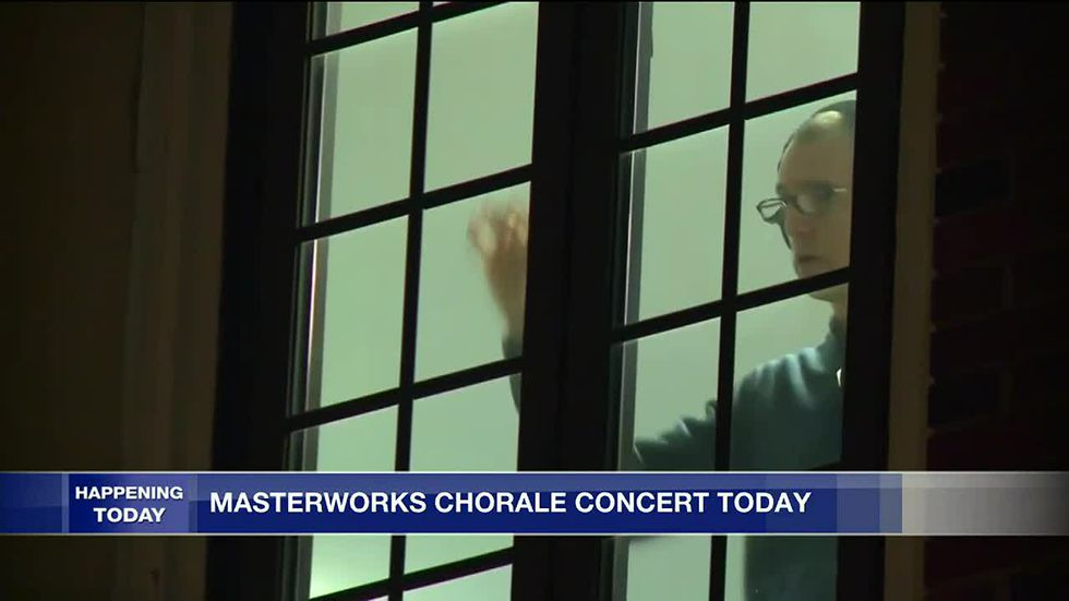 Artistic Director Tim Cloeter conducts from an upstairs window at the church (Tony Geftos, WTVG).