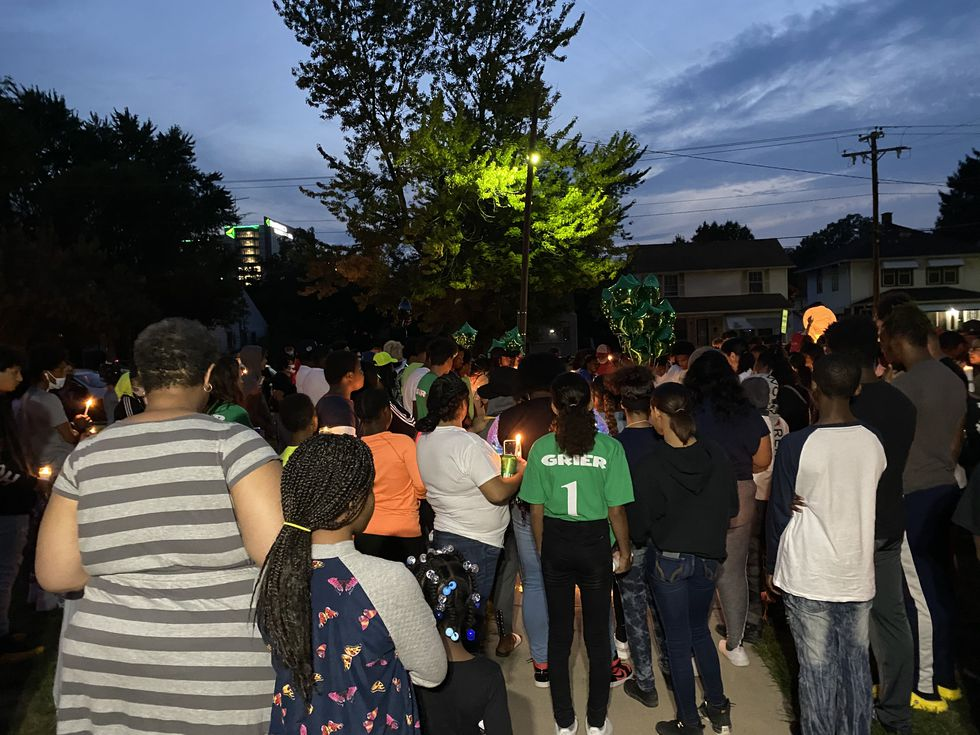 A packed crowd surrounds the front yard of Nareon Grier's home, rembering the life of the 17-year old Start High School junior