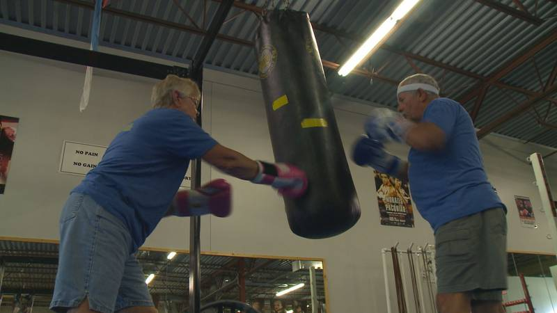 A wife and husband participate in a Punch Out Parkinson's Disease at International Boxing Club.