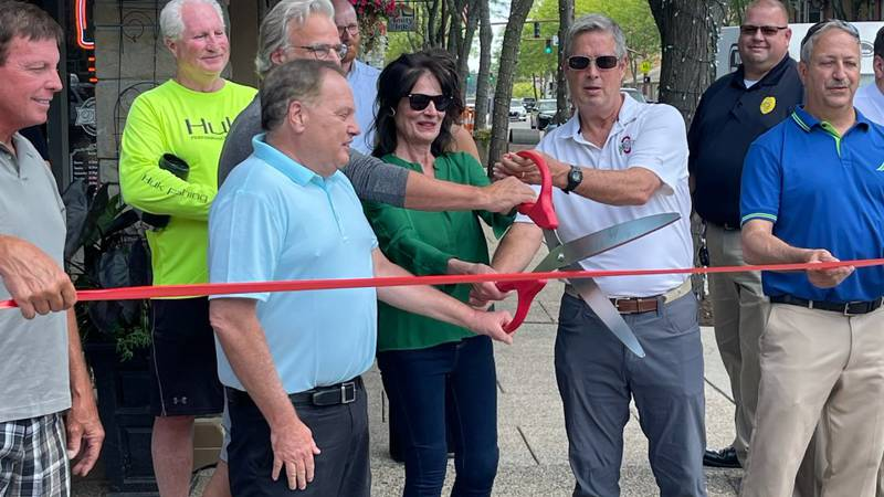 Mayor Carr and council members cut the ribbon at the opening