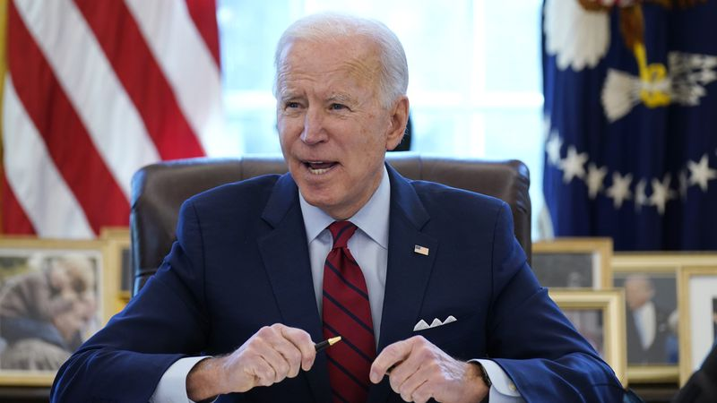 FILE - In this Jan. 28, 2021 file photo, President Joe Biden signs a series of executive orders...