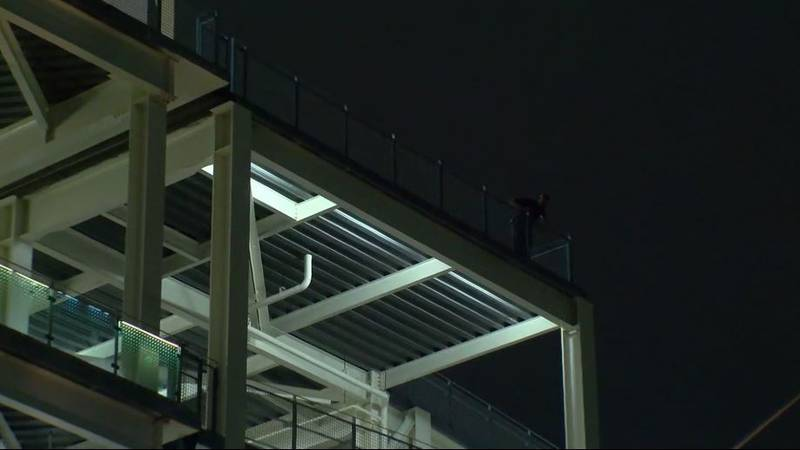 Police say a 40-year-old mother and her 2-year-old son died after falling from the third level...