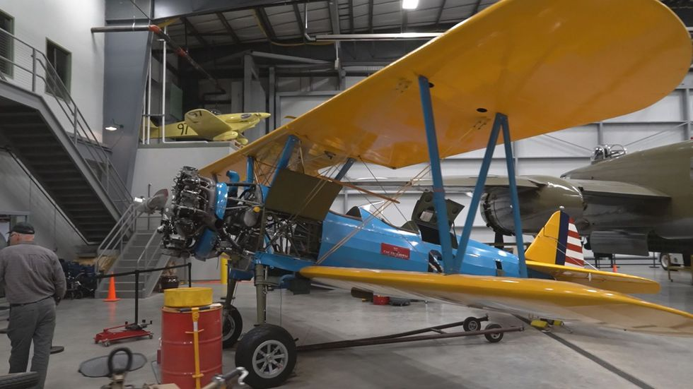 Mechanics work on a plane during the off season at Liberty Aviation Museum.