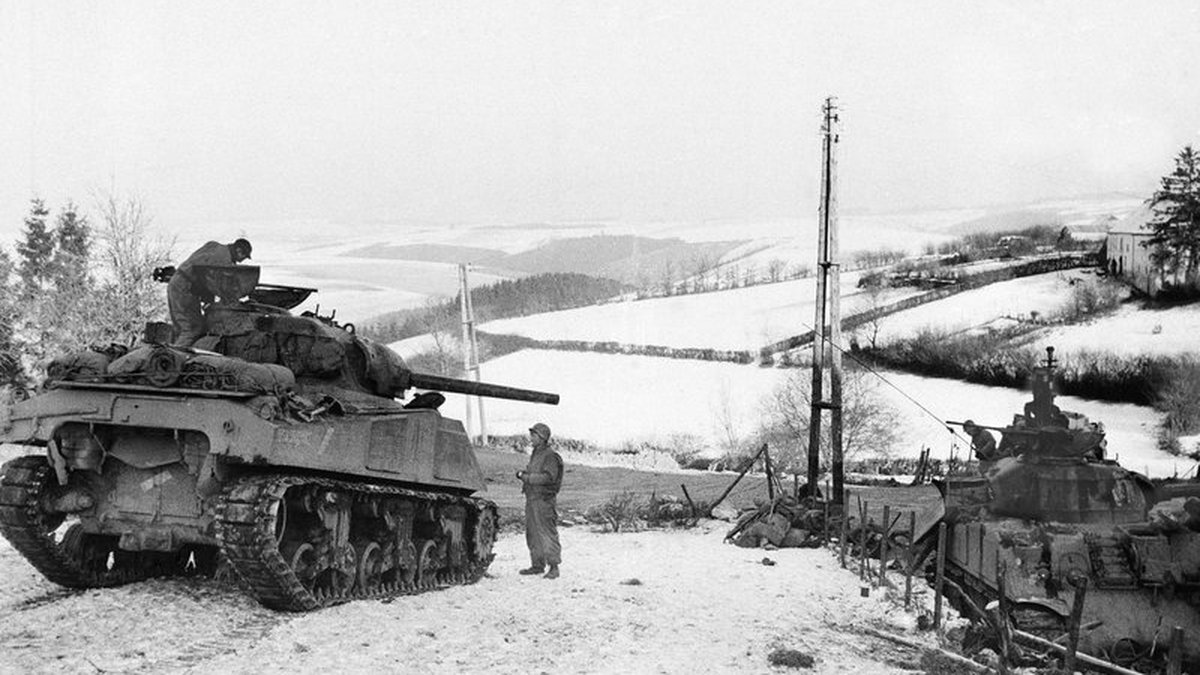 In this Jan. 6, 1945 file photo, American tanks wait on the snowy slopes in Bastogne,Belgium....