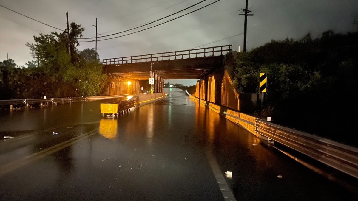 Flood waters block traffic on the underpass leading into Delta.