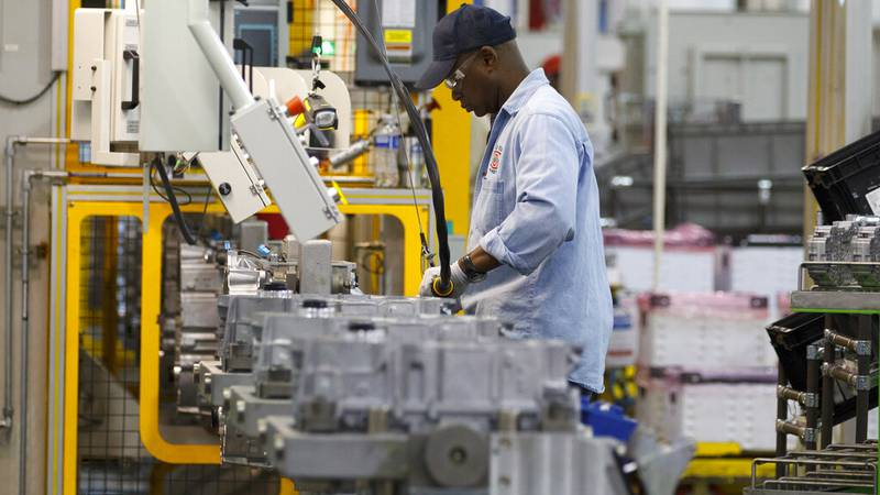 In this May 10, 2011 photo an autoworker assembles a transmission at the General Motors...