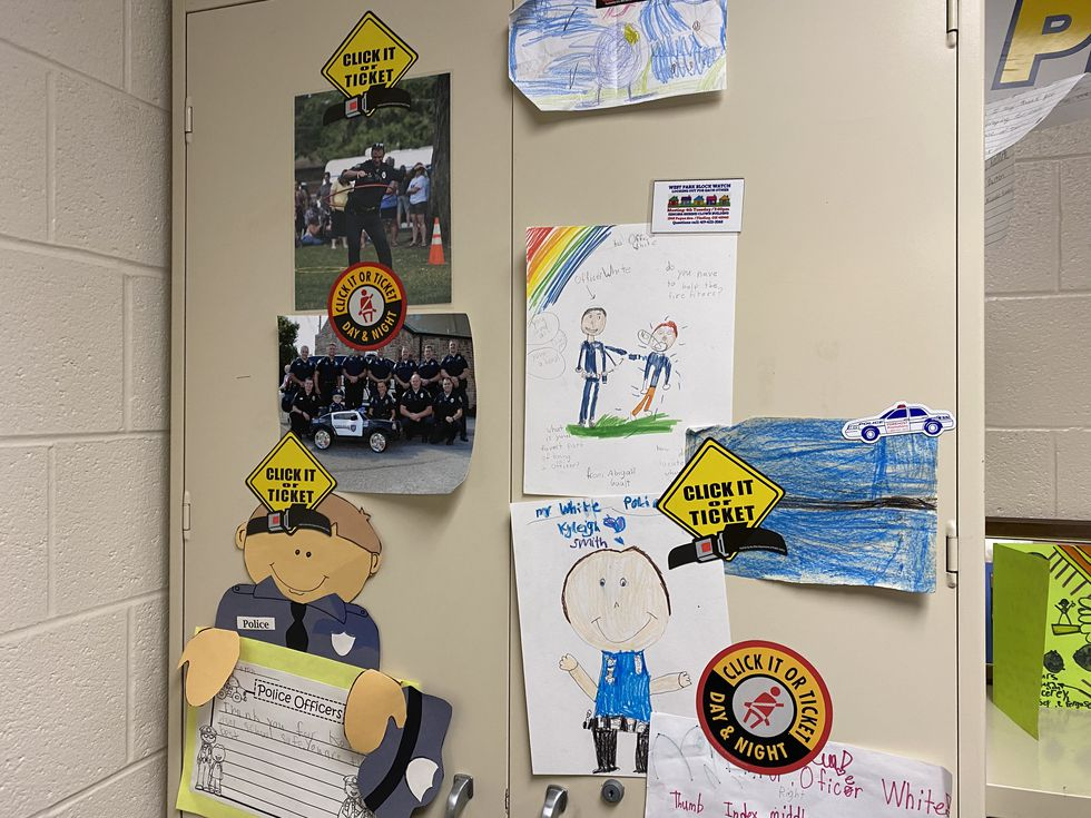 The artwork, letters, and notes of children fill the walls of Brian White's office, thanking...