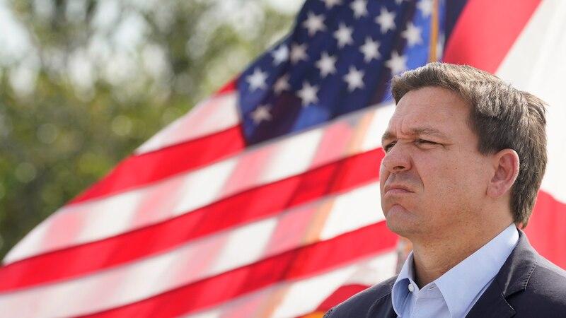 Florida Gov. Ron DeSantis listens during a news conference, Tuesday, Aug. 3, 2021, near the...