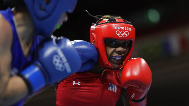 Oshae Jones, from the United States, right, exchanges punches with Mexico's Brianda Tamara Cruz...