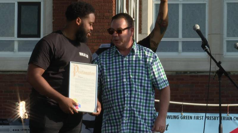 He presents BRAVE president Anthony King with a proclamation.