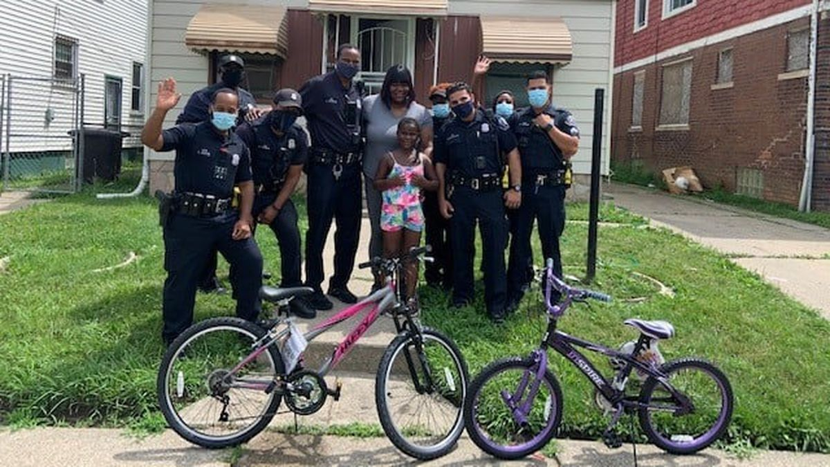 The officers of the Detroit Police Department's second precinct arranged to get each girl a new bicycle.