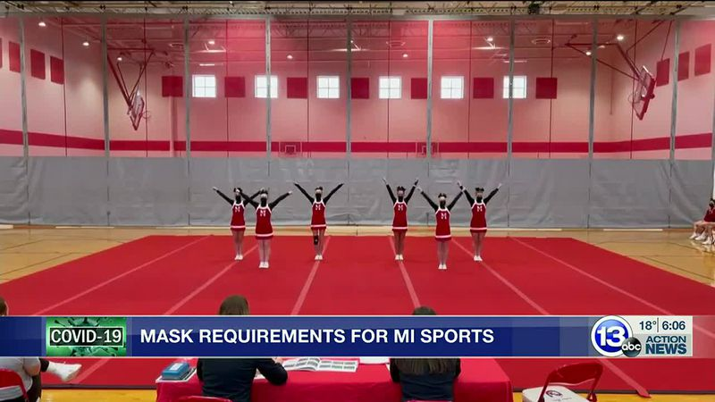 Michigan cheerleaders required to wear masks during competitions