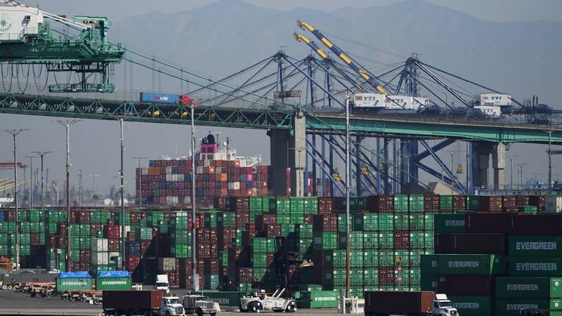 Containers are stacked at the Port of Los Angeles in Los Angeles, Friday, Oct. 1, 2021. (AP...