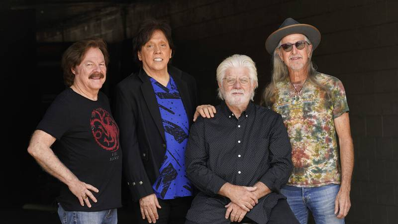 Members of the Doobie Brothers, from left, Tom Johnston, John McFee, Michael McDonald and Pat...