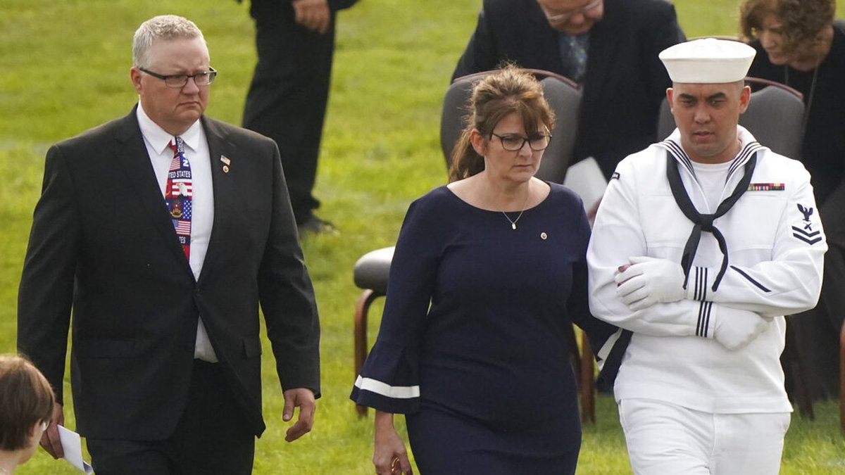 Kip and Rachel Soviak, parents of Navy Corpsman Maxton Soviak, are escorted to their seats...