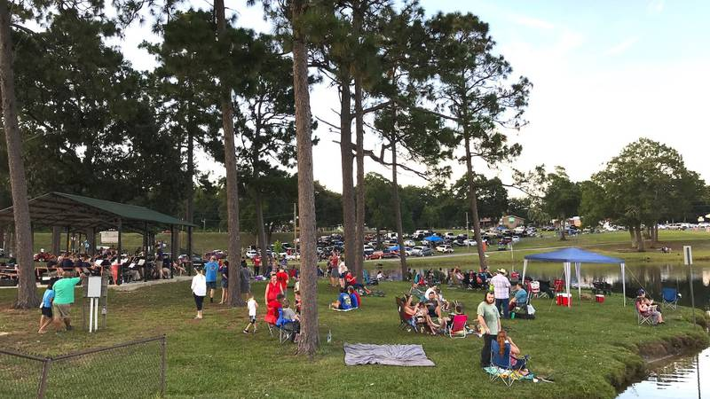 Residents stake out spots in Twin Hills Park to watch the 2019 Independence Day fireworks. This...