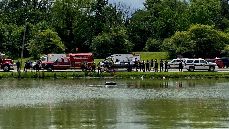 Crews are the scene after a car drove into a pond in East Toledo on Tuesday, June 15.