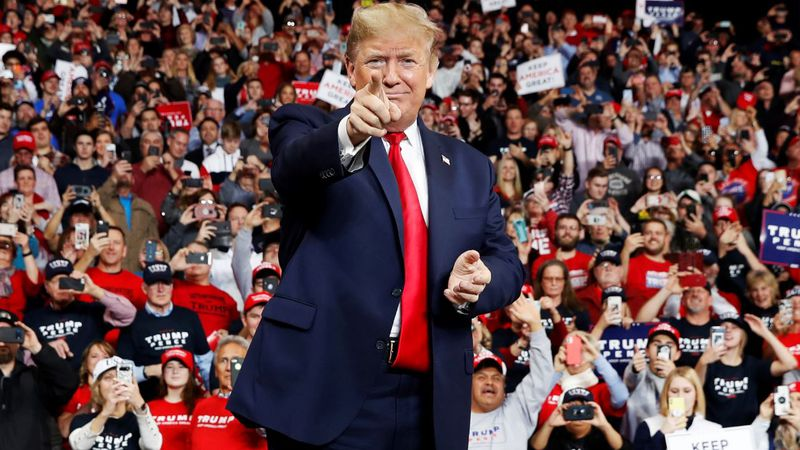President Donald Trump points as he arrives to speak at a campaign rally, Thursday, Jan. 9, in...