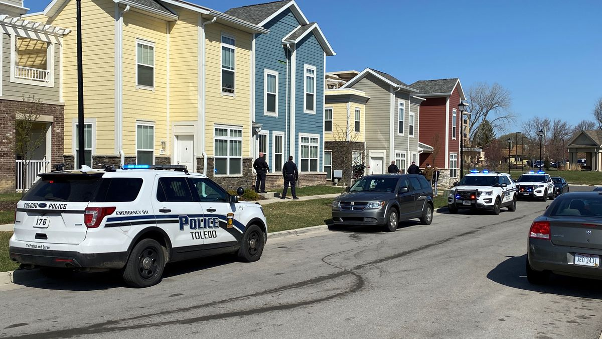 Police investigate a shooting on Rogan Way Wednesday morning.