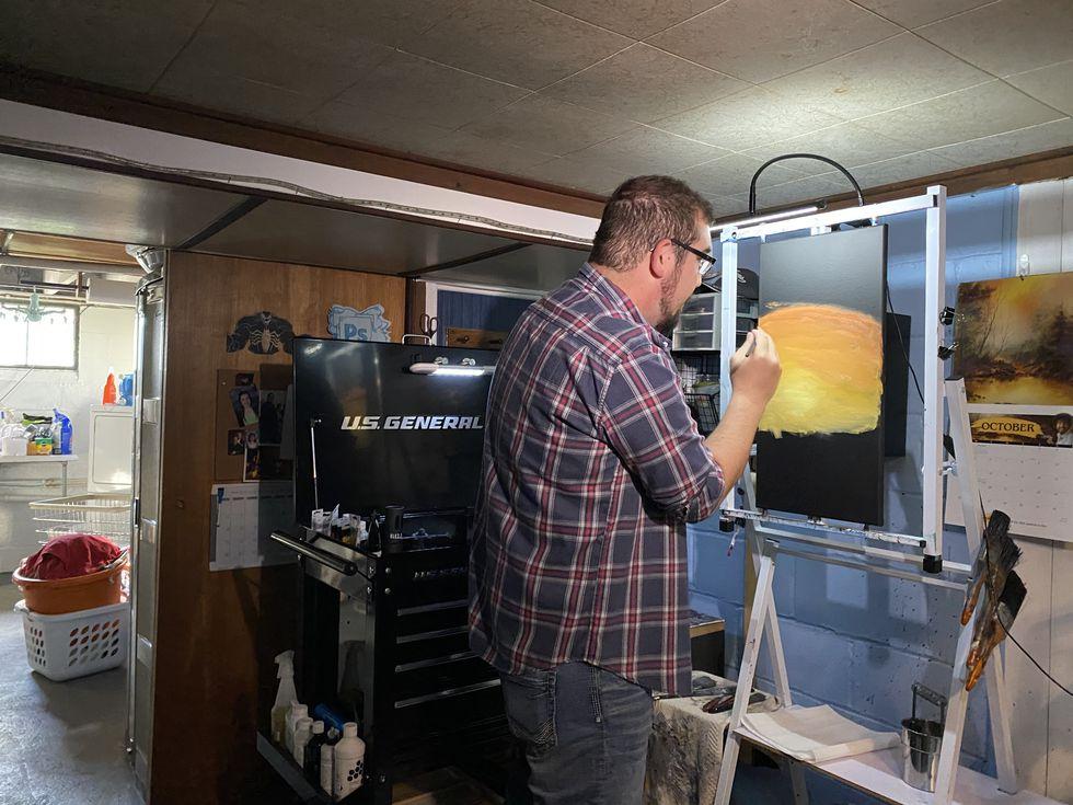 Rick Fravor hard at work painting inside his studio.