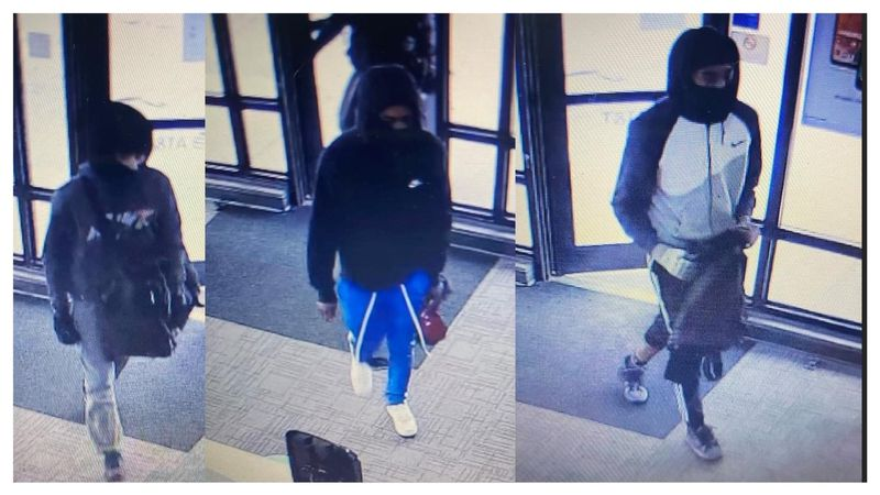 Maumee Police are searching for 3 people who robbed an AT&T store.
