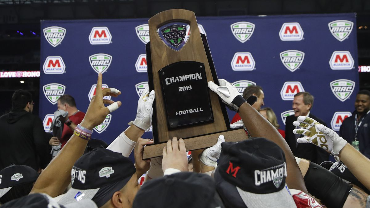FILE - In this Dec. 7, 2019, file photo, members of the Miami of Ohio team hold the champion...