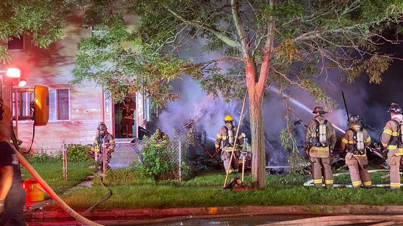 Flames were 50-60 feet high when firefighters arrived at the scene on Chase St.