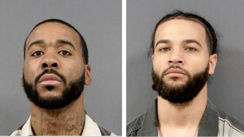 Austin Watkins, right, turned himself in to the Monroe County Sheriff's office for questioning...