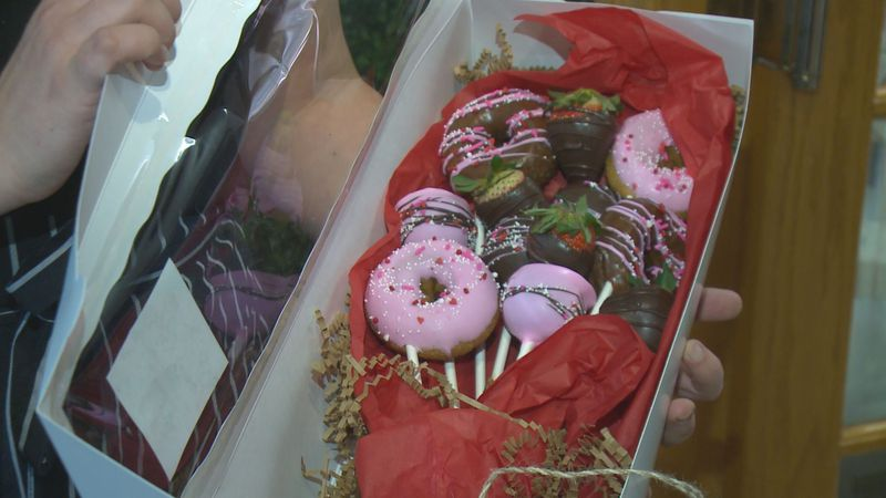 A cake pop, donut, chocolate-covered strawberry bouquet is a hot seller for Valentine's Day at...