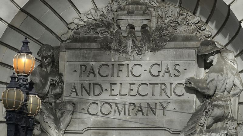 FILE - In this Oct. 10, 2019, file photo, a Pacific Gas & Electric sign is shown outside of a...