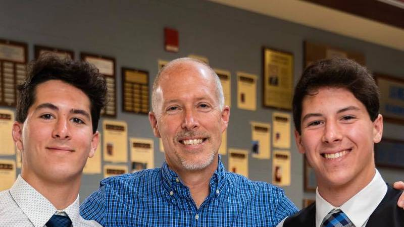 Twins graduate with Top Honors