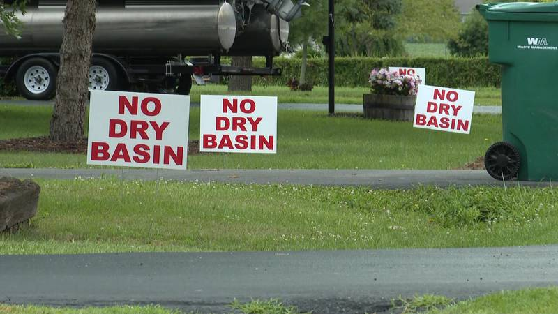 Residents of Findlay are split on plans to build a dry river basin to curb flooding.