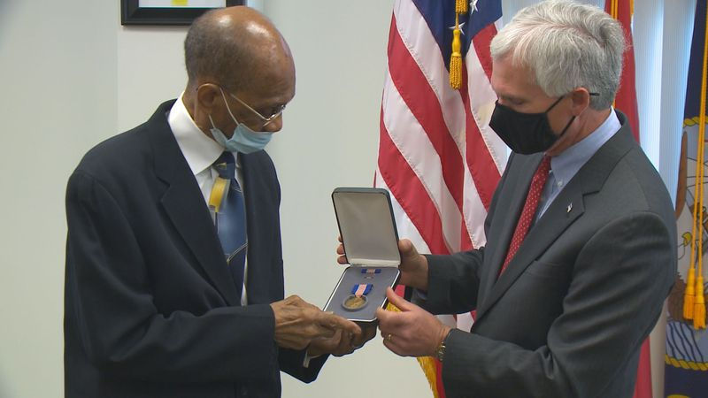 PFC Wilbur Lewis received The Soldier's Medal for saving a fellow paratrooper in midair during...